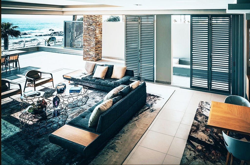 a room filled with furniture on a modern rug near and a large window