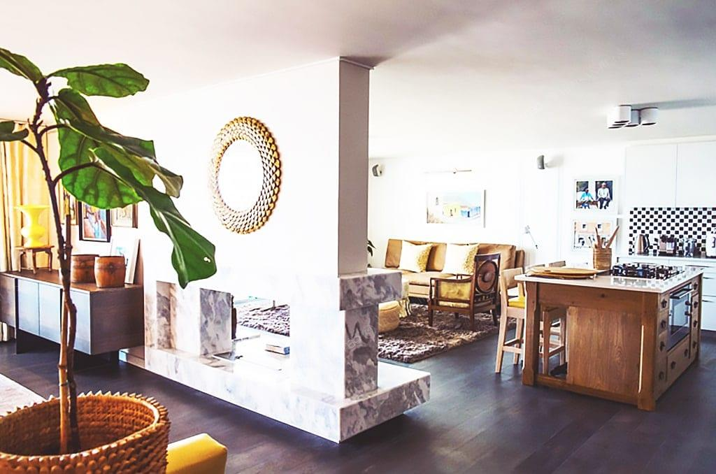 a living room filled with furniture on top of a wooden table