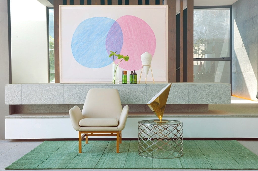 modern lamp and living room furniture on a green rug