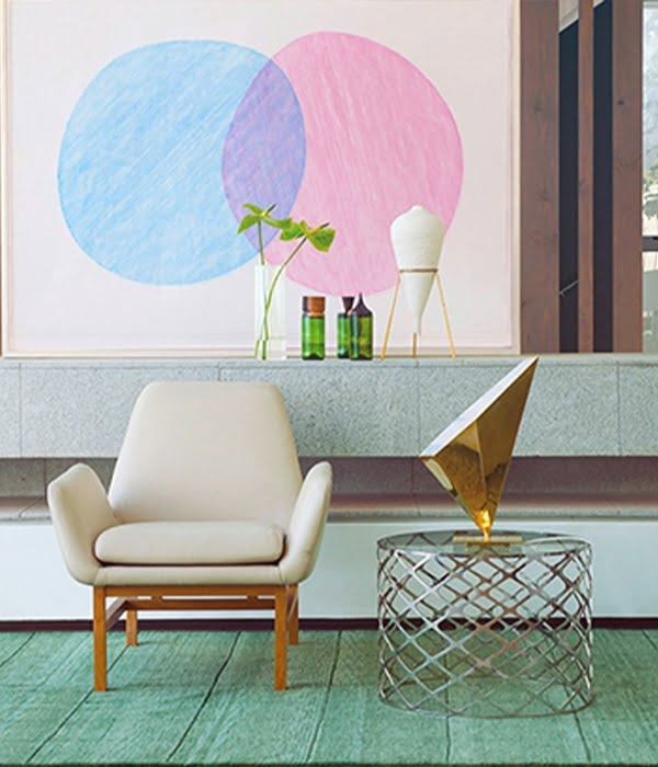 Chair and coffee table on a green rug